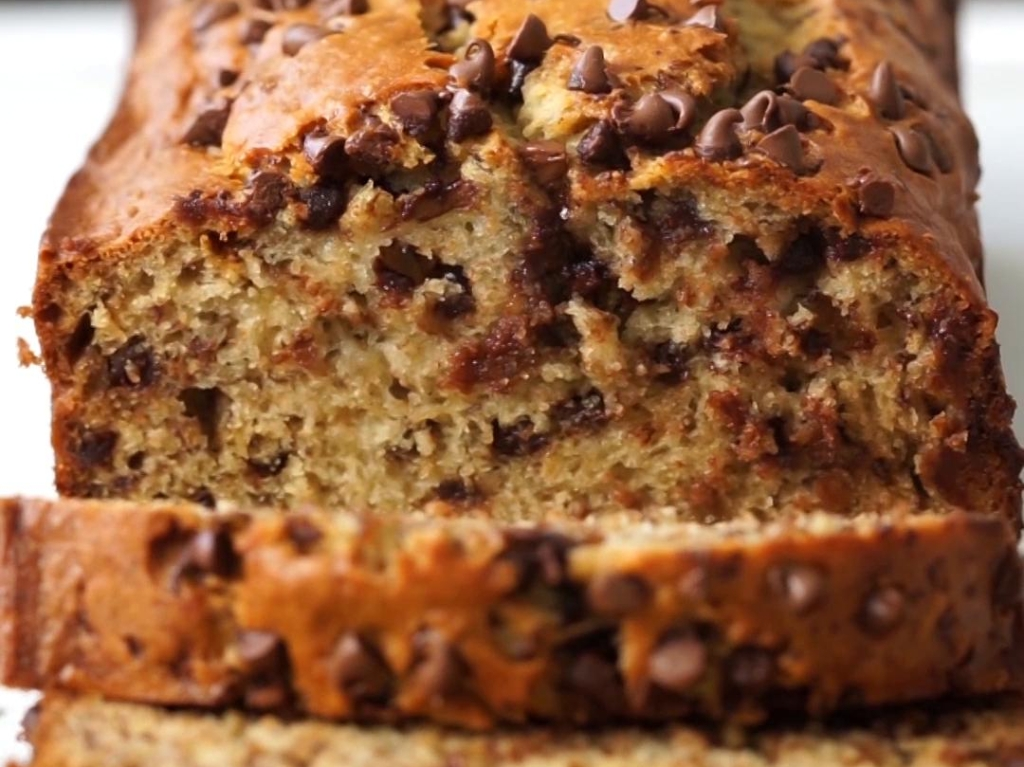 Up close view of sliced pumpkin loaf with chocolate chips.