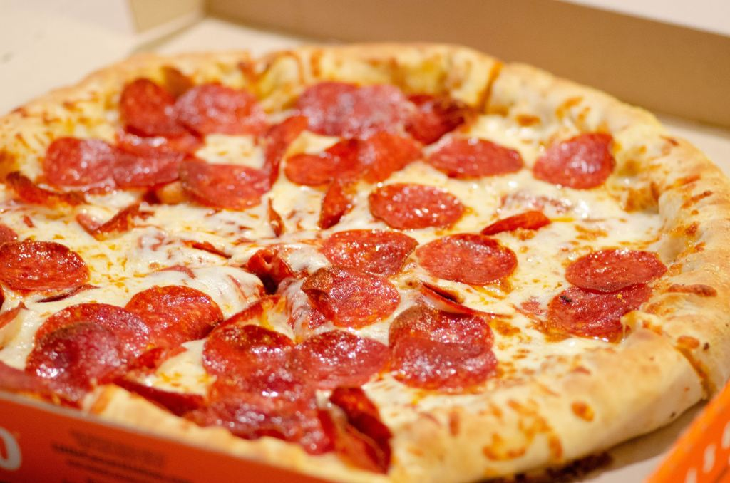 Close up of pepperoni pizza in take out box